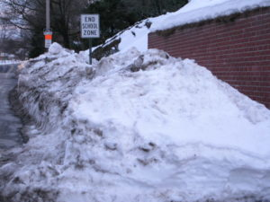 Six-foot high mountains of snow in the Taylor Elementary school zone (file photo)
