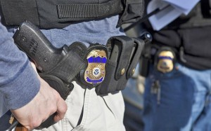 An armed U.S. Immigration and Customs Enforcement agent in Northern Virginia (photo courtesy ICE)