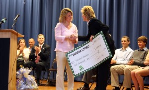 "Second grade teacher Elizabeth Abraham is presented with the Va. Lottery ""Super Teacher"" award (courtesy Frank Bellavia/APS)"