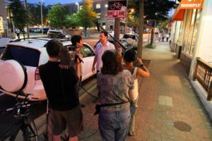 Arlington Independent Media students interview a subject on Wilson Boulevard in Clarendon