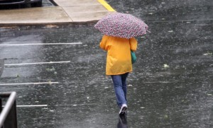 Woman walks through the wind and rain caused by Hurricane Irene (file photo)