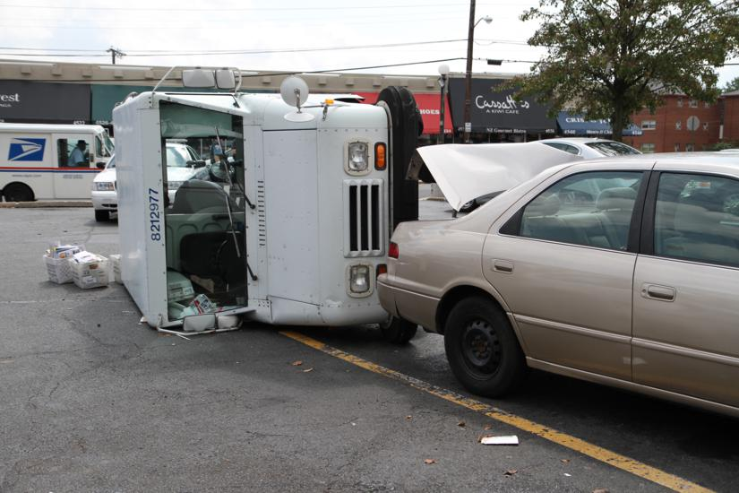Mail Truck Overturns in 7-Eleven Parking Lot | ARLnow com