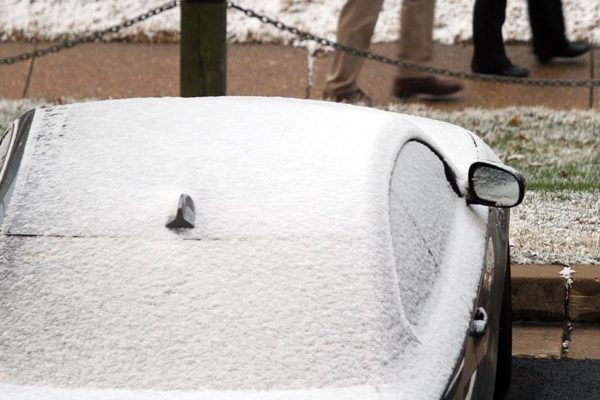 A dusting of snow covers a car in Pentagon City