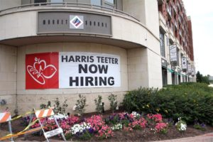 'Now Hiring' sign outside the Harris Teeter store near Potomac Yard
