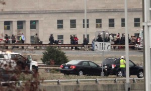 Commuters lined up on the side of I-395 after their bus caught fire