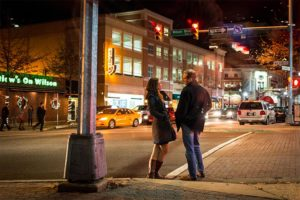 Two people talking on a Clarendon sidewalk (Flickr photo by Ddimick)