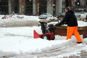 Workers clear sidewalks during snowstorm in Ballston
