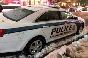 Arlington police car parked in the snow (file photo)