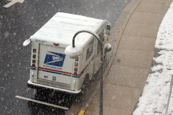 A US Postal Service truck in the snow