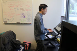Encore Alert Founder/CEO James LI works at his UberOffices workspace