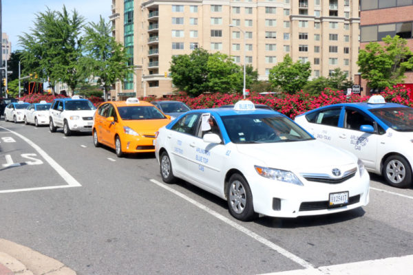 Taxi drivers protest Uber and Lyft with road slowdown in Courthouse