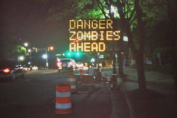 Hacked road sign on Columbia Pike warns of zombies ahead (photo courtesy celialarsen)
