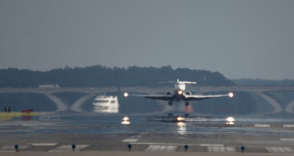Plane above the runway at DCA, Reagan National Airport (Flickr pool photo by John Sonderman)