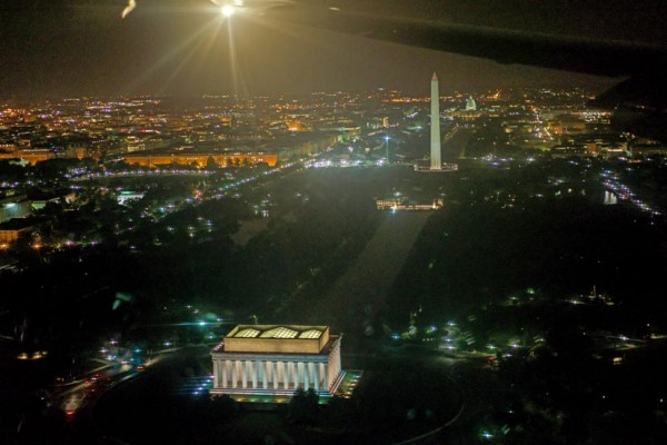 View of Washington D.C. and monuments at night, as seen from an arriving flight (Flickr pool photo by Wolfkann)