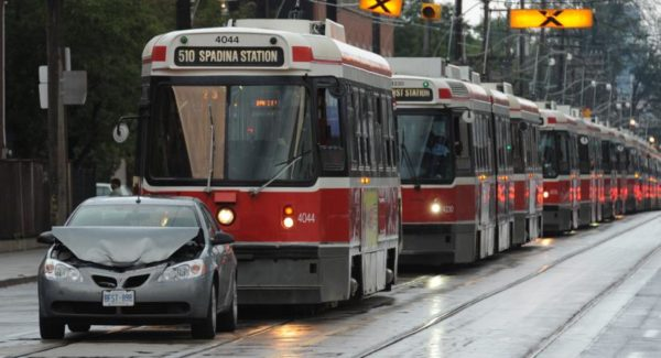 Streetcars in Toronto held up by a car accident (photo by Rick Eglinton/GetStock)