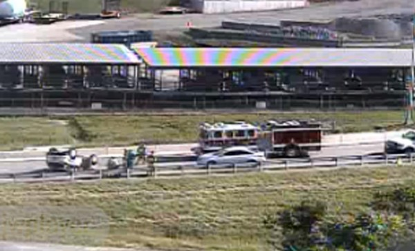 Accident involving an overturned vehicle on the SB I-395 ramp to Washington Blvd