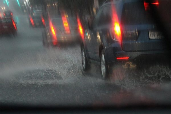 Columbia Pike is flooded by a downpour / heavy rain