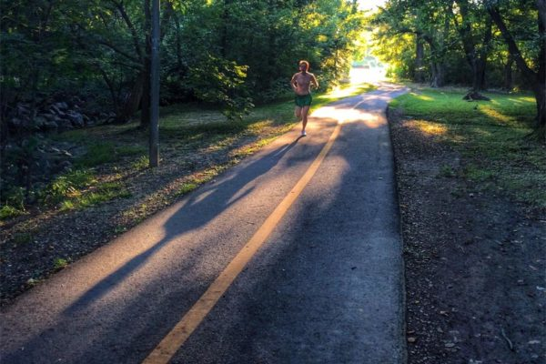Shadowy jogger in Banneker Park (Flickr pool photo by Dennis Dimick)