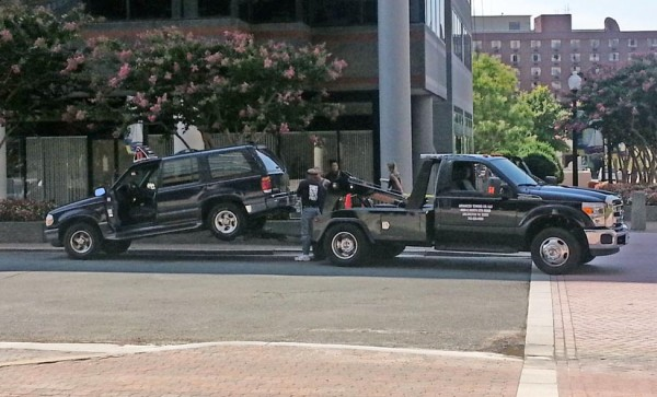A Jimmy John's delivery vehicle is towed
