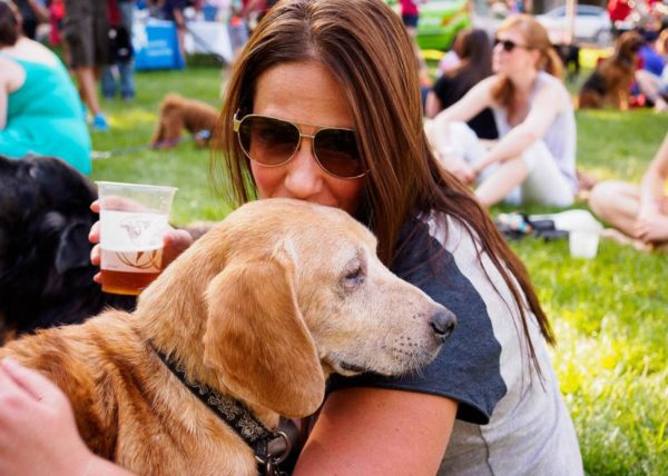A woman and her dog at last week's Pups and Pilsners event in Crystal City (Flickr pool photo by Rob Cannon)