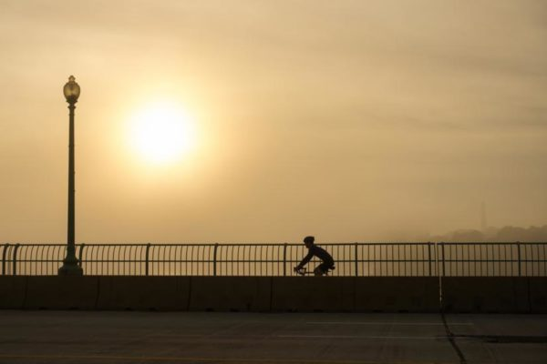 Bicyclist and morning fog (Flickr pool photo by Wolfkann)