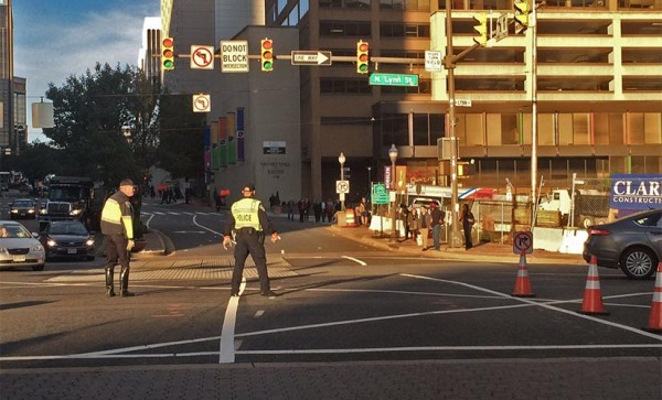Police directing traffic at the intersection of Wilson Blvd and N. Lynn Street on the morning of 10/20/14