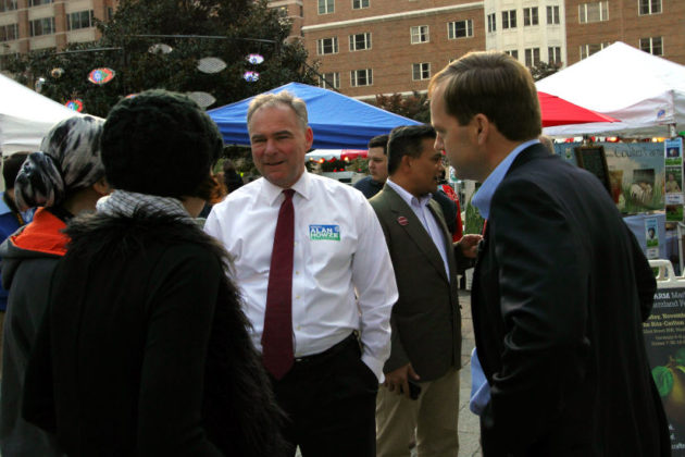 Sen. Tim Kaine with Alan Howze at the Ballston Farmers Market in October 2014