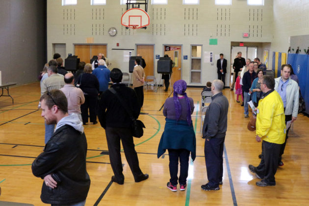 The line to vote in the gymnasium of Arlington Traditional School