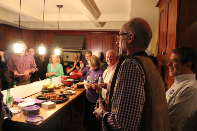 John Vihstadt listens to results being read at his election party
