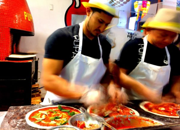 Pizza makers at Pupatella in Bluemont (Flickr pool photo by Chris)