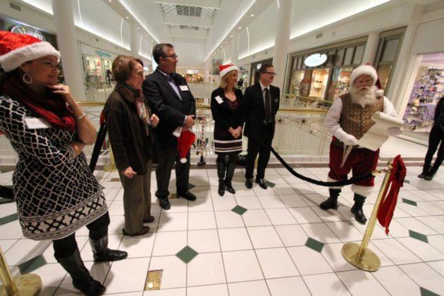 "Santa Claus reads a renovation ""wish list"""