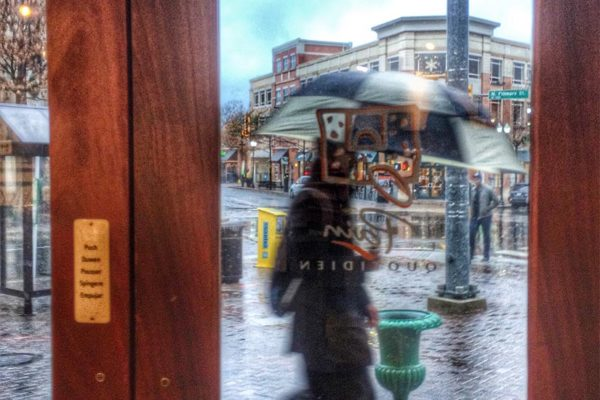 Woman with umbrella on a rainy day in Clarendon (Flickr pool photo by Dennis Dimick)