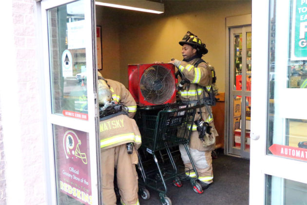 Firefighters use fans to ventilate the Harris Teeter after a chemical leak