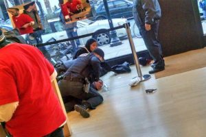 Man arrested in the Apple Store (photo courtesy Clayton Lott)