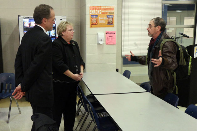 A resident talks with County Manager Barbara Donnellan and APS Superintendent Patrick Murphy