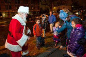 Santa greets children at the Miracle on 23rd Street (photo courtesy Linden Resources)