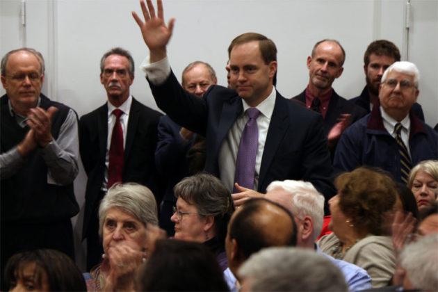 Vihstadt's opponent, Democrat Alan Howze, waves during Vihstadt's swearing in