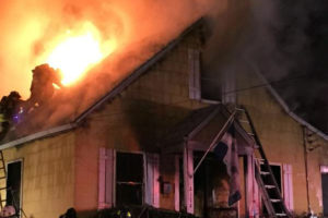 Firefighters work to put out a house fire on the 2100 block of S. Randolph Street (photo via @IAFF2800)