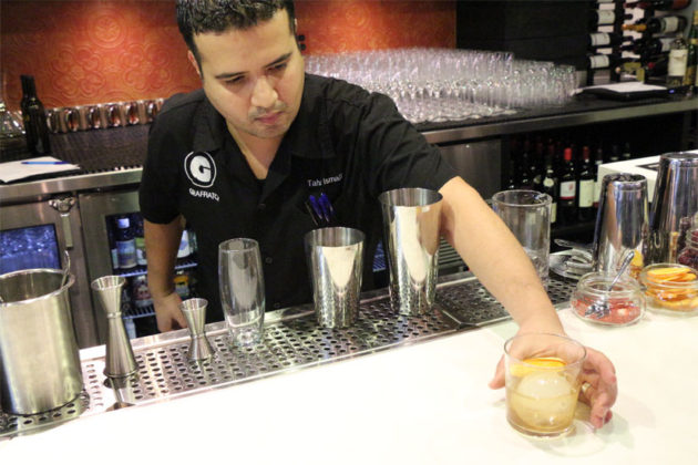 Beverage Director Taha Ismail serves a papa bear cocktail
