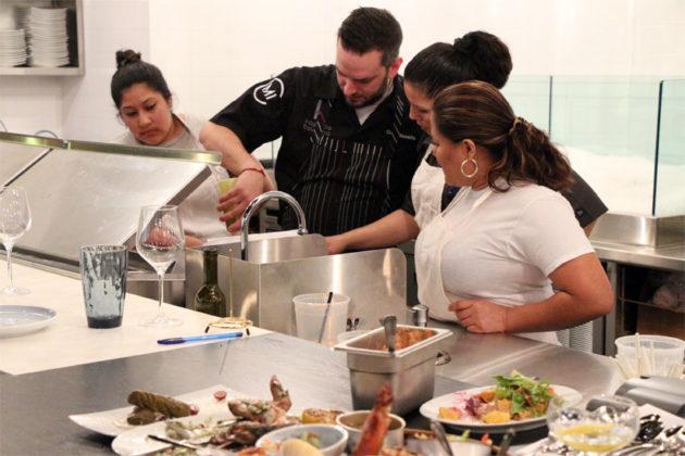 Chef de cuisine Greg Basalla prepares a dish at Kapnos Taverna