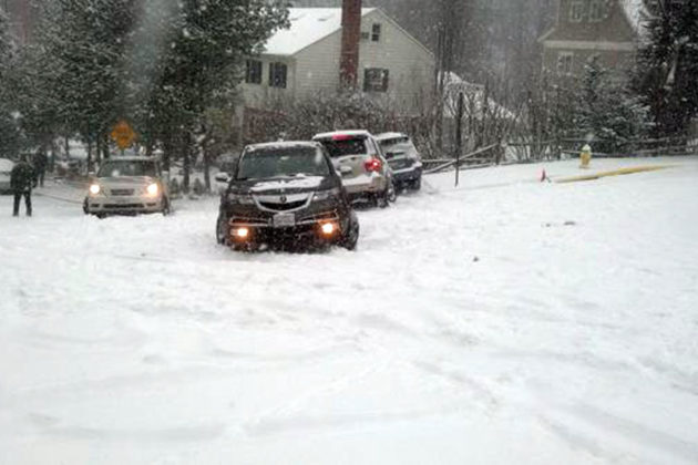 Cars stuck on a hill on 36th Street N. near Jamestown Elementary (photo courtesy @SteevPearson)