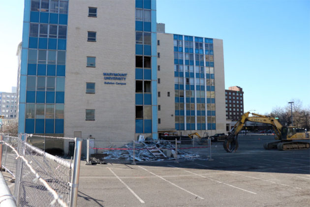 Debris surrounds the north side of the Blue Goose building