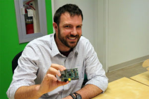 Dexter Industries Founder John Cole and the RaspberryPi computer that powers his robots