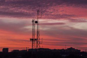 Radio antennas in South Arlington at sunset