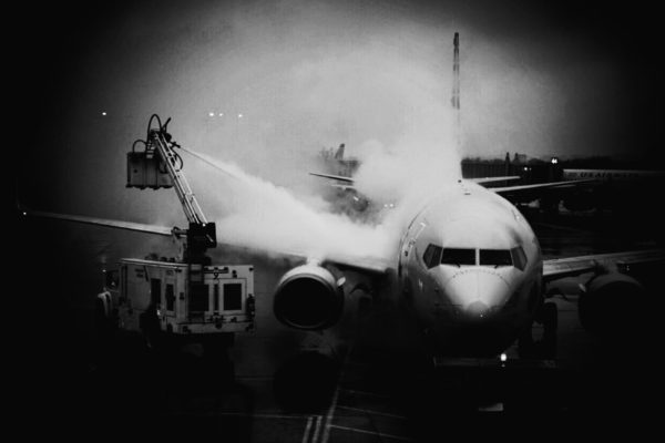 De-icing a plane at Reagan National Airport (Flickr pool photo by Kevin Wolf)