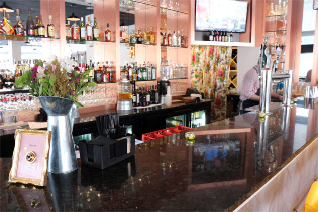 "The bar at SER in Ballston, with a ""push for Sangria"" button"