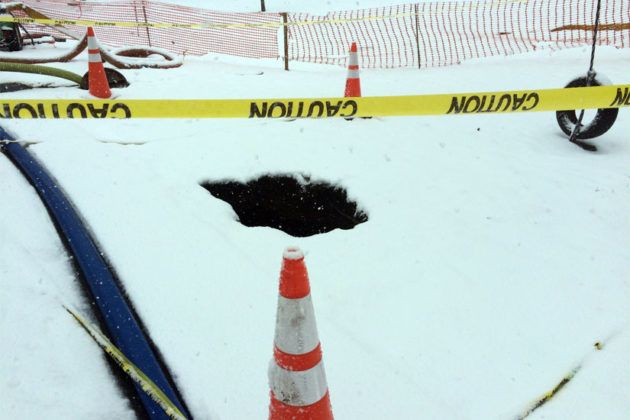 A sinkhole at the corner of 1st Street N. and Edgewood Street (photo courtesy Chris Timura)