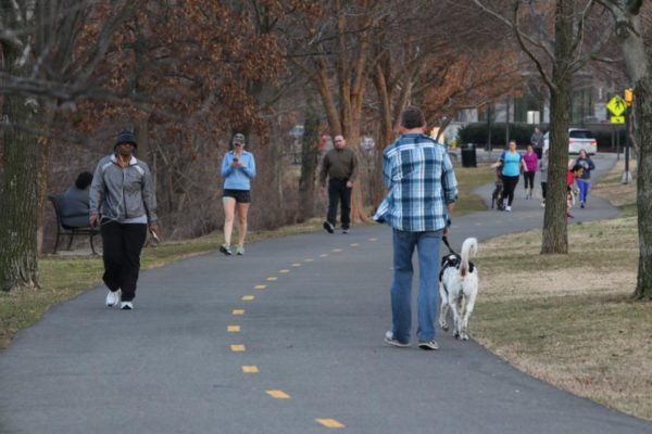 Residents take advantage of warm weather on a trail near Shirlington 3/11/15
