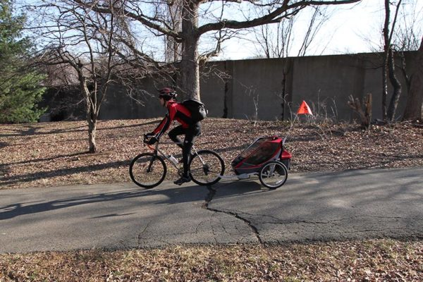 Bicyclist on the Custis Trail with child