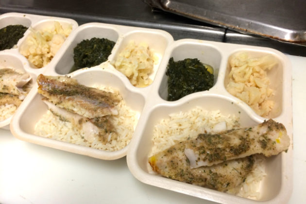 Tilapia entree prepared for donation to Meals on Wheels